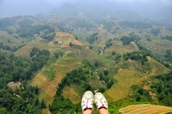 Looking over the edge into a valley of rice terraces