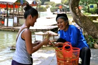 Buying Corn from an elderly Zhuang woman