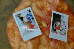 Two of the polaroids on a bag of puffed rice snacks they shared with us