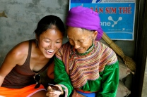 Ting and an old Flower Hmong woman enjoying her photo together