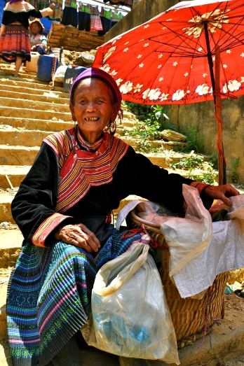 Flower Hmong woman selling sticky rice at Can Cau Market