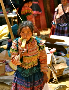 Flower Hmong girl having a popsicle at Can Cau Market