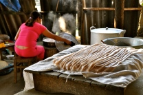 Woman making pho noodles from scratch at her home in Bac Ha