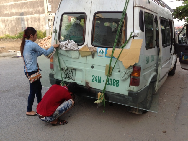 Strapping glass to our minibus