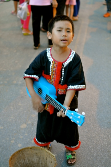 A boy performing on the walking street