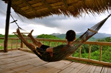 Lounging on our bungalow's porch at Bamboo Nest