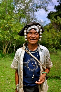 Akha woman posing in her field