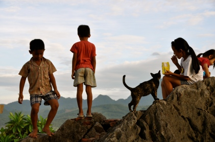 Children and the temple cat waiting for sunset