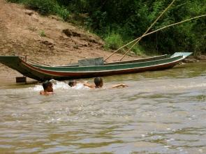 Kids swimming in the Nam Ou River