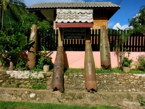 A guesthouse sign decorated with US bomb casings