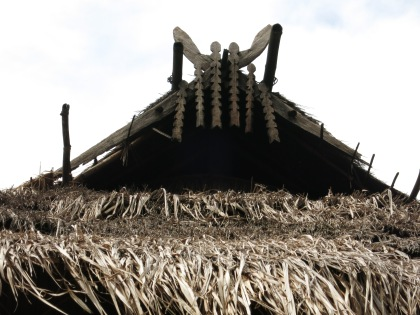 Roof ornaments denoting the number of family members in an Akha home